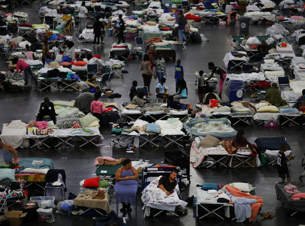 Evacuees affected by Tropical Storm Harvey take shelter at the George R Brown Convention Center in downtown Houston
