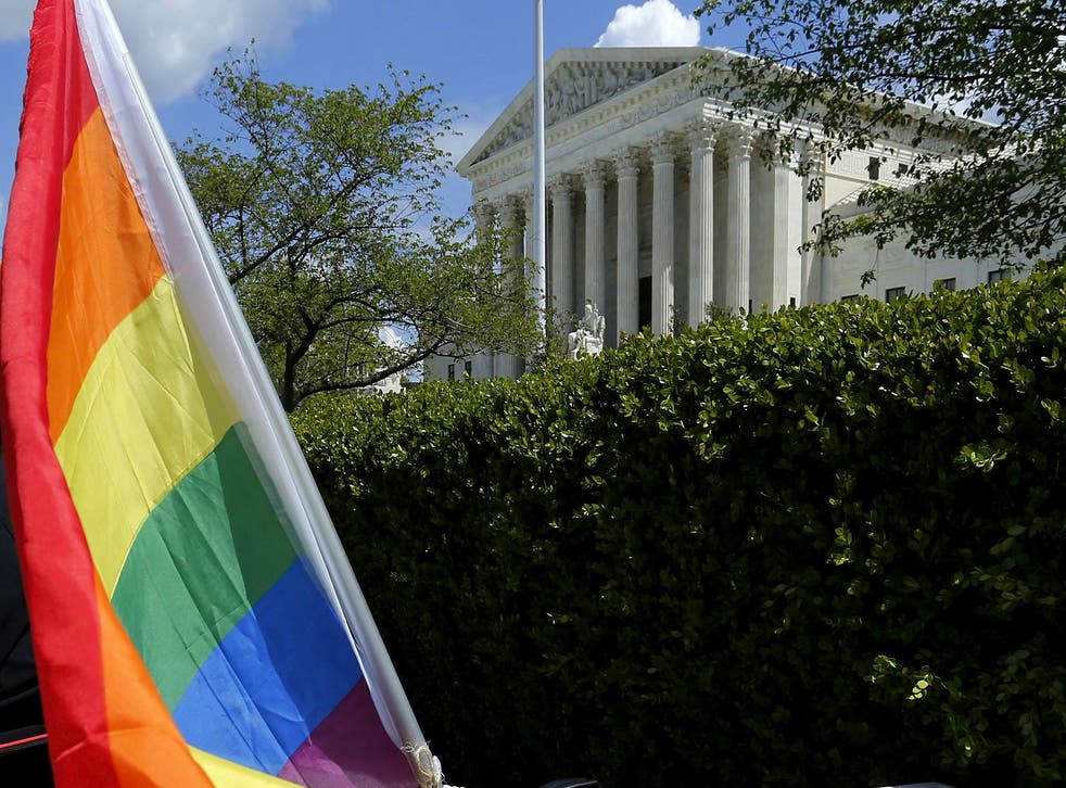 A rainbow coloured flag is seen outside the US Supreme Court in Washington