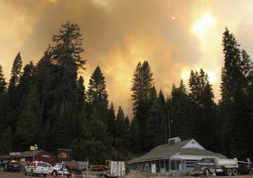 Us heatwave deserts burn in triple digit temperatures as california smoke rises from a wildfire behind the fish camp general store near yosemite national park fandeluxe Image collections