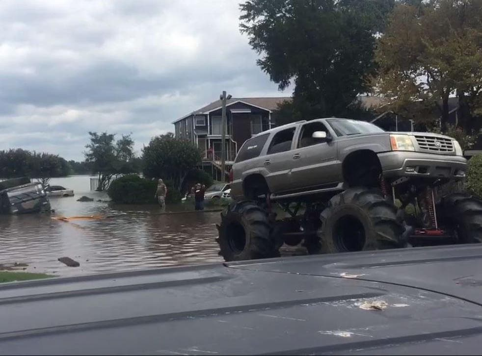 One large-wheeled vehicle pulled an army lorry from the flood waters