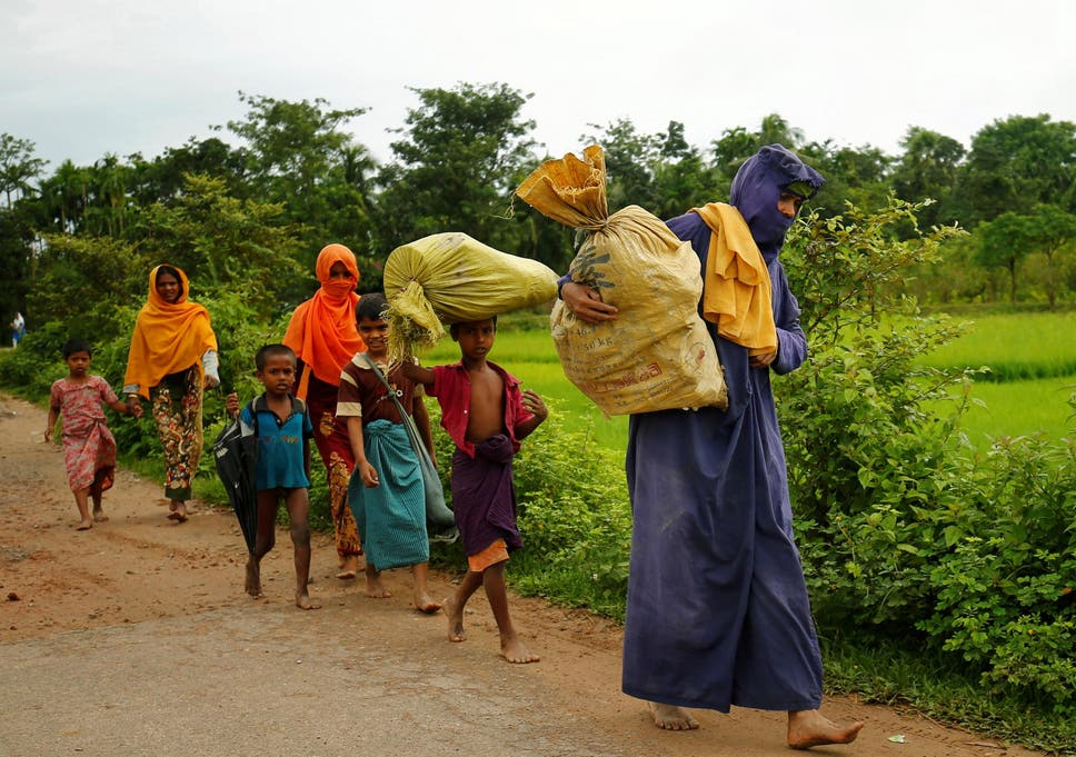 Rohingyas Walk Along The Road To Reach To The Refugee Camp After Crossing The Border In