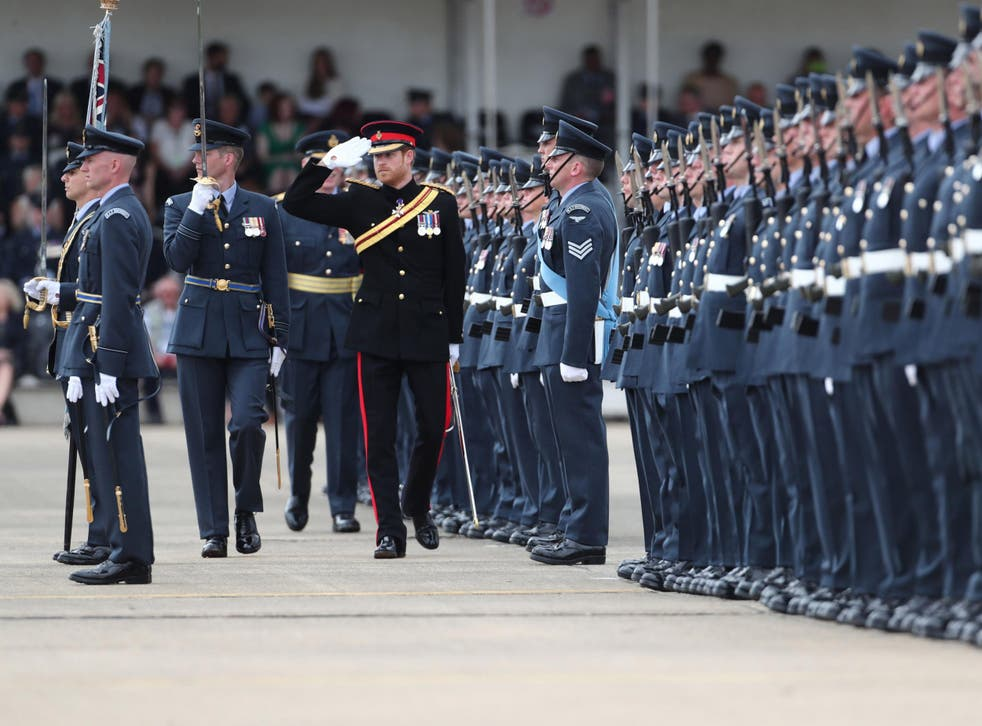 Prince Harry inspects an honour guard at RAF Honington in Suffolk