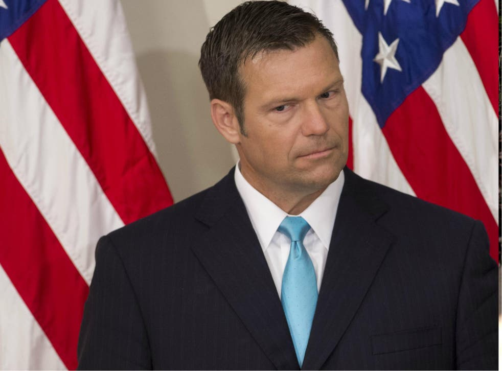 Kansas Secretary of State Kris Kobach is the head of Donald Trump's election fraud commission and also a paid columnist for right-wing Breitbart News