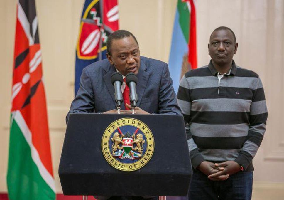 kenyas president uhuru kenyatta flanked by his deputy william ruto addresses the nation on