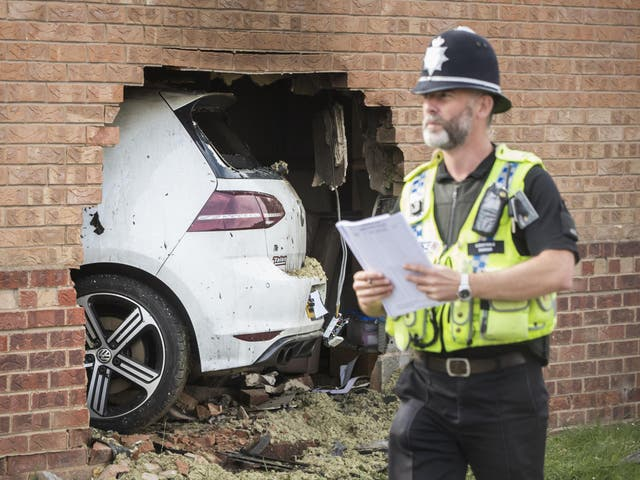 The scene in Morehall Close, Clifton, York, after a Volkswagen Golf R left the road and hit a house where a man inside the property suffered serious injuries, although they are not believed to be life threatening, PRESS ASSOCIATION Photo. Picture date: Sunday September 3, 2017.