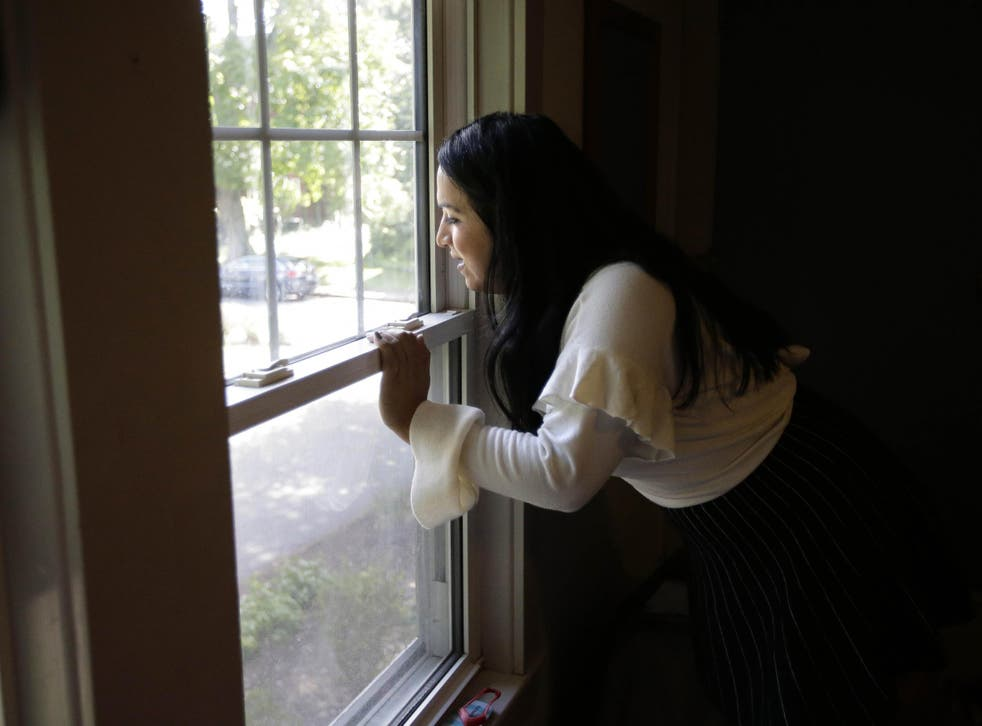 Ninotska Love, who has been accepted at Wellesley College, looks out a window in her dorm room at the women's school in Wellesley, Massachusetts