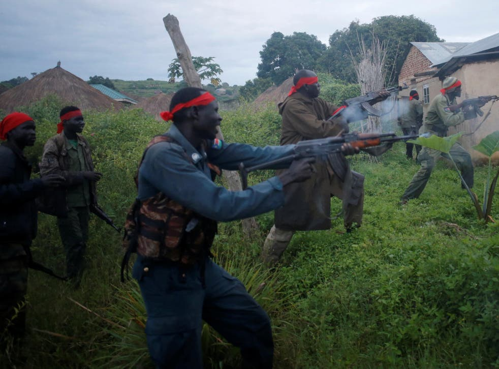 Rebels fighting government troops in Kaya, South Sudan, last month