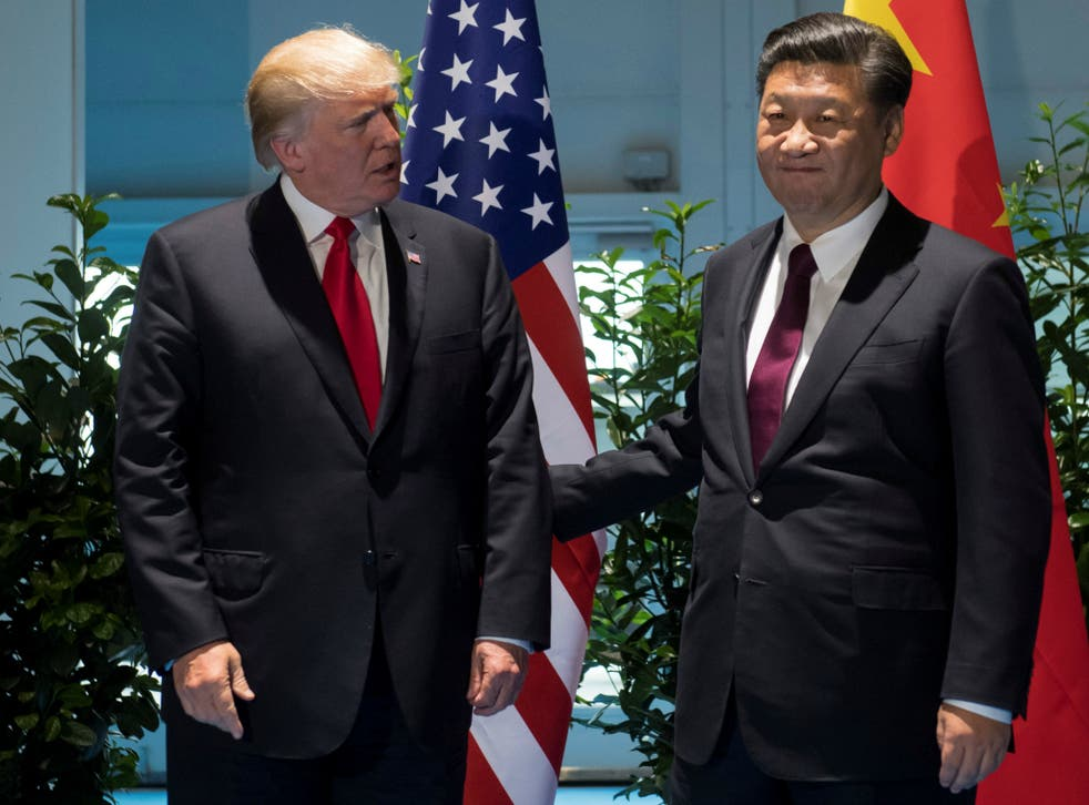 U.S. President Donald Trump and Chinese President Xi Jinping, seen here at the G20 Summit in Hamburg, Germany on July 8, 2017, discussed options for containing the North Korean threat