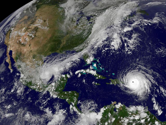 Hurricane Irma churns across the Atlantic Ocean past Puerto Rico over Dominican Republic in this Nasa satellite image