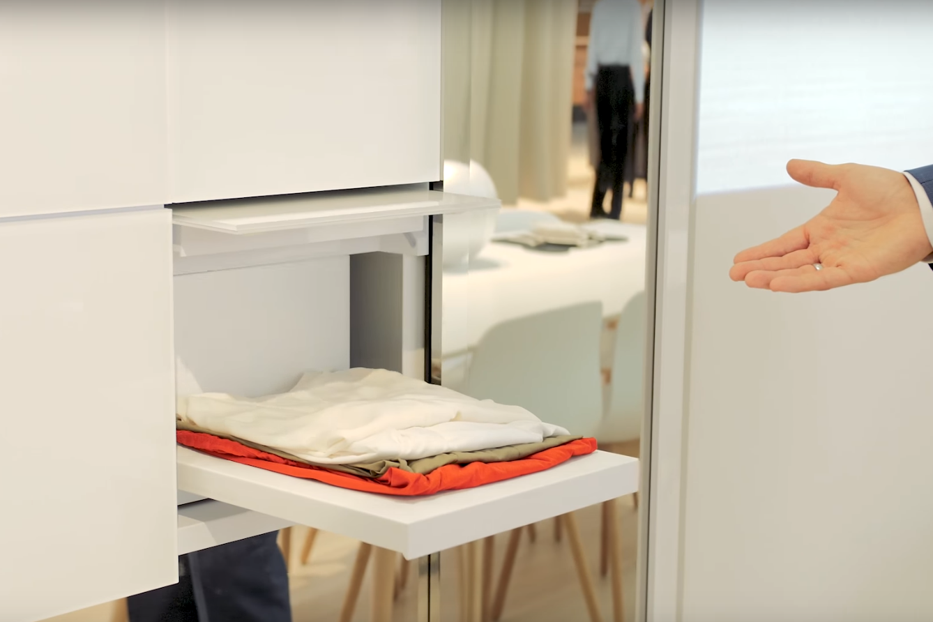 Prototype Panasonic washing machine has robot arms that fold clean clothes