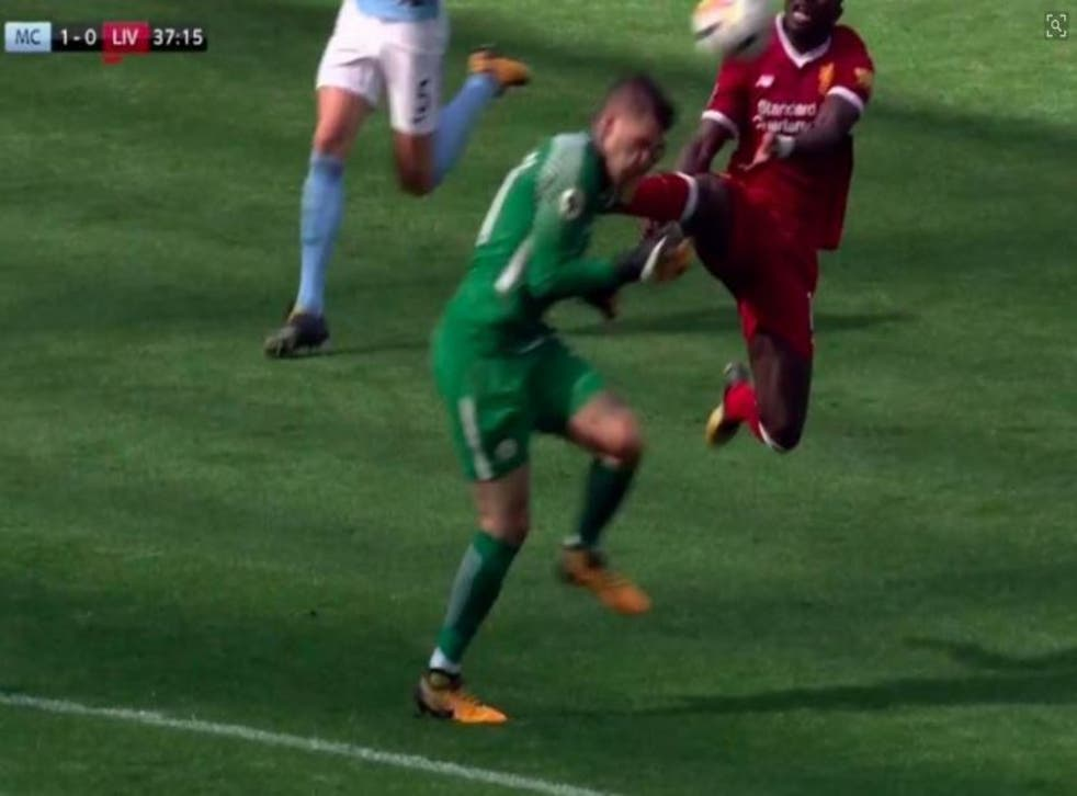 Ederson is caught in the face by Sadio Mane's raised foot