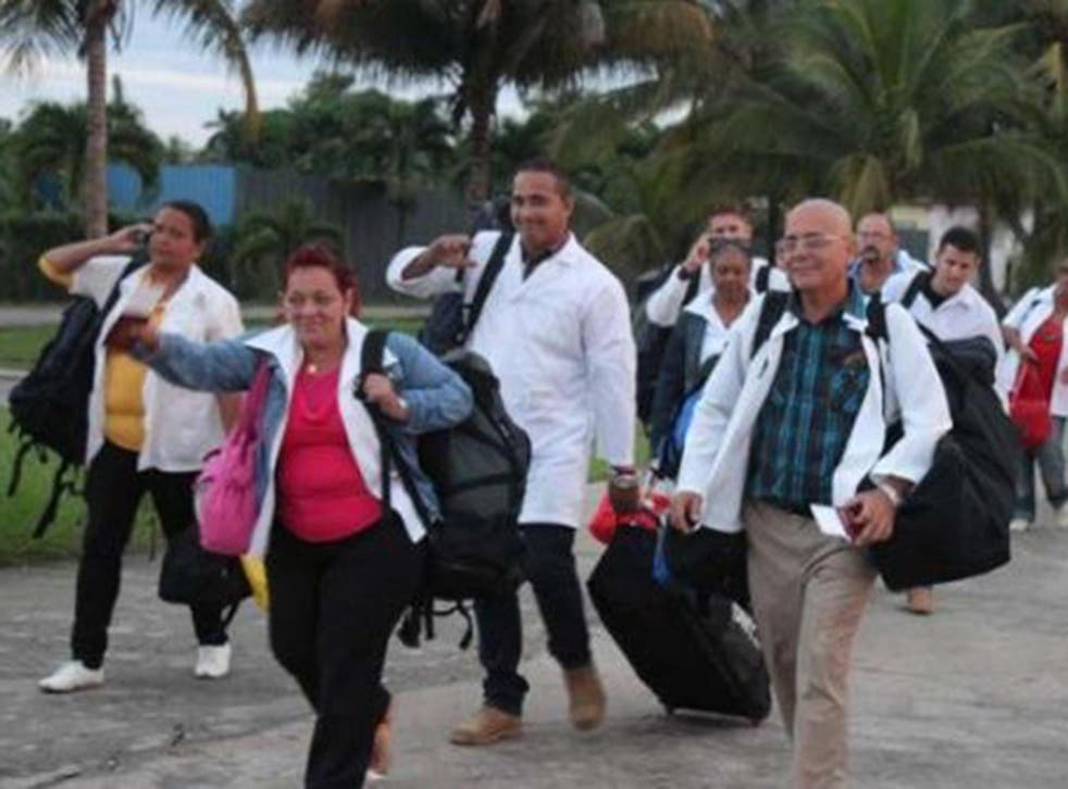 Cuban doctors on a trip to Dominica to help after Tropical Storm Erika