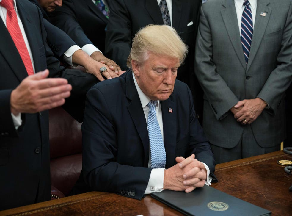 Donald Trump and faith leaders pray in the Oval Office at the White House
