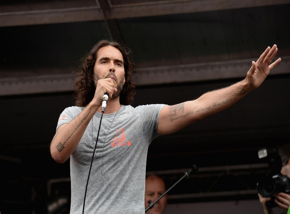 Comedian Russell Brand speaks to thousands of demonstrators gathered in Parliament Square to protest against austerity and spending cuts in 2015