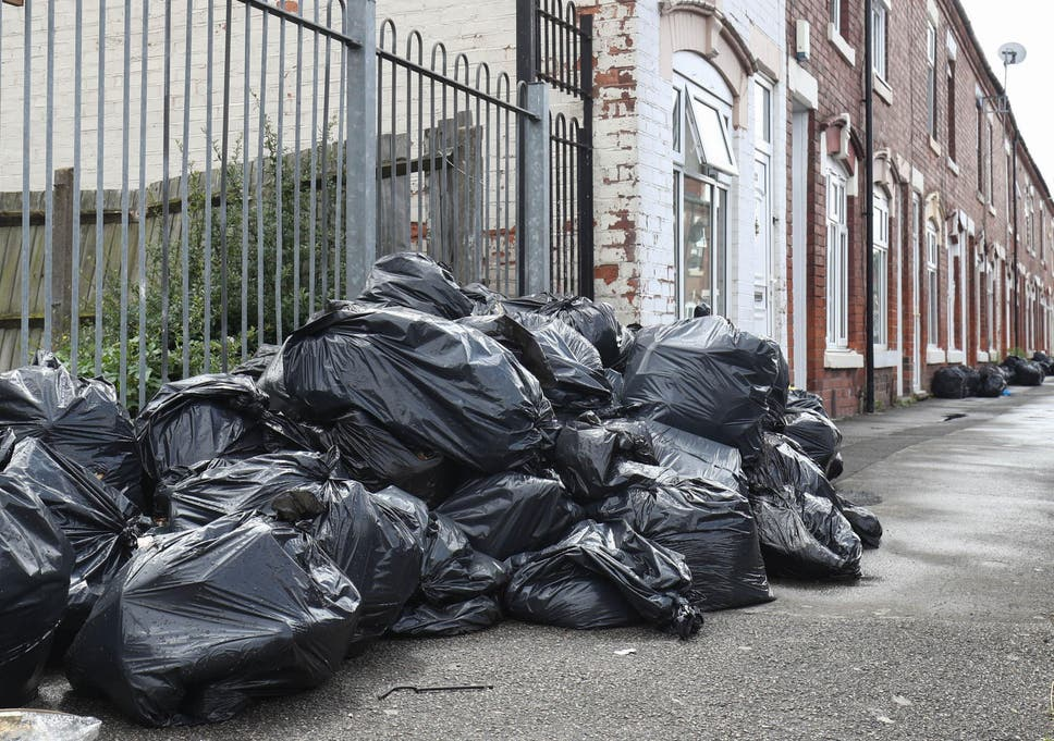 Birmingham city council leader john clancy resigns as bin strike rubbish bags piled high in tarry road birmingham as bin workers are set to thecheapjerseys Choice Image