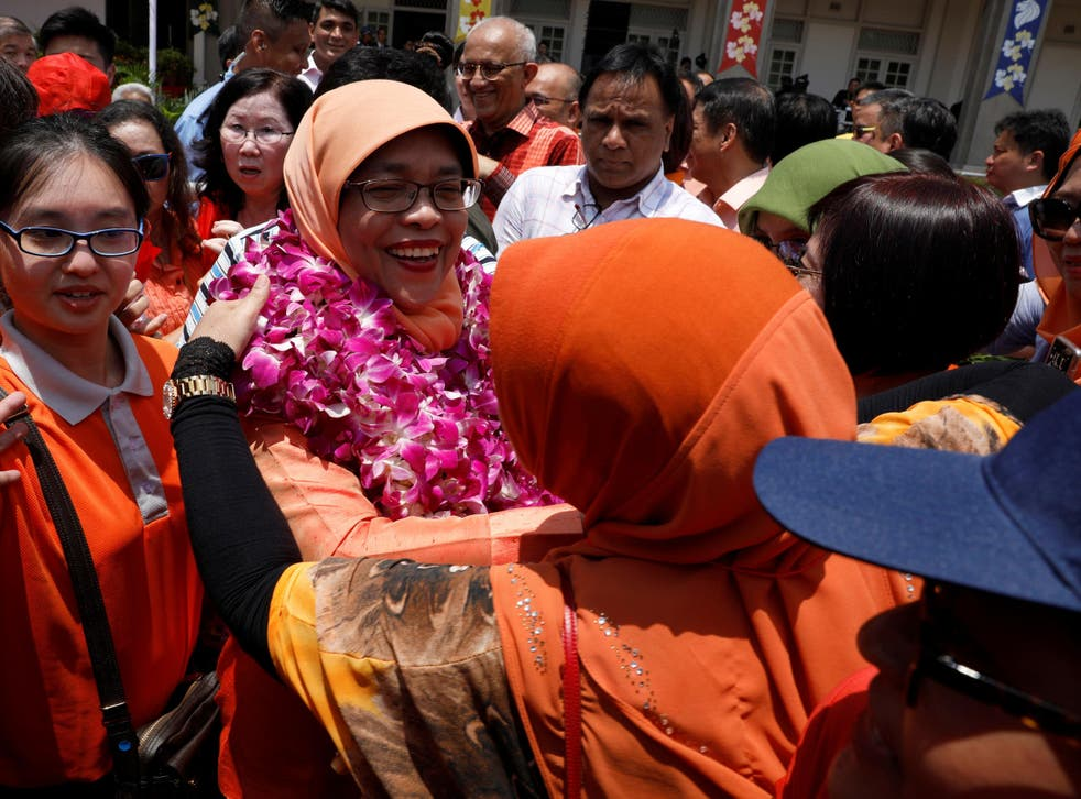 Singapore's President-elect Halimah Yacob leaves the nomination centre in Singapore