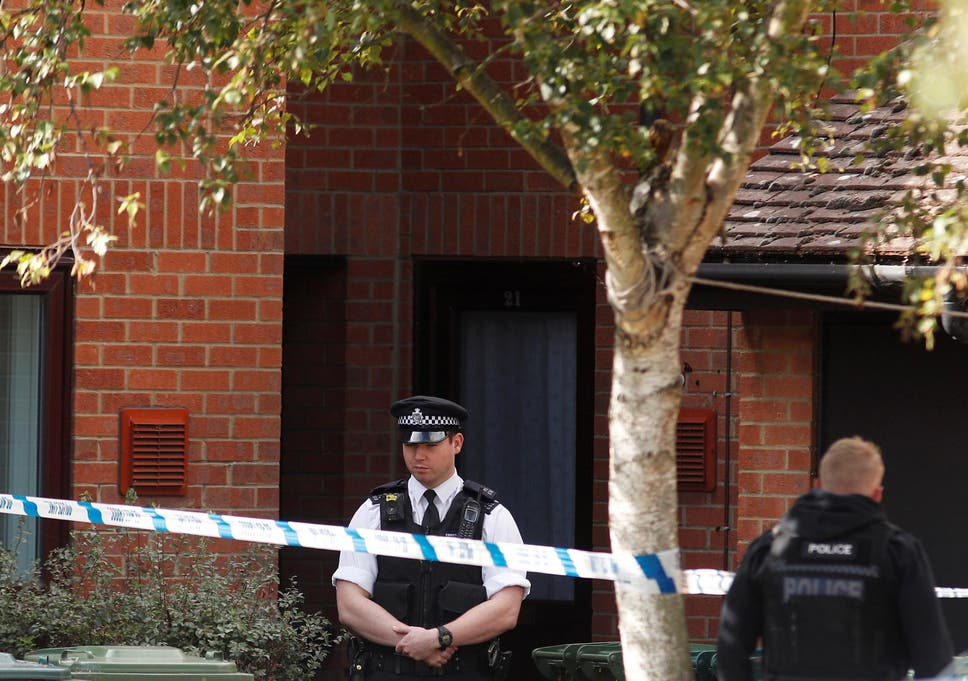 Police forensic teams search second Surrey property after