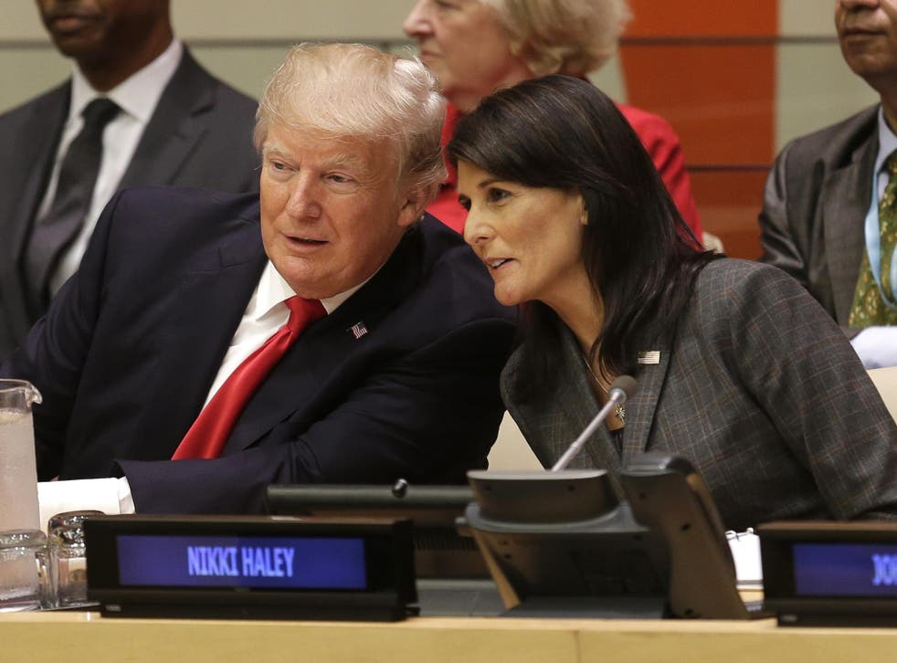 US President Donald Trump speaks with US Ambassador to the United Nations Nikki Haley