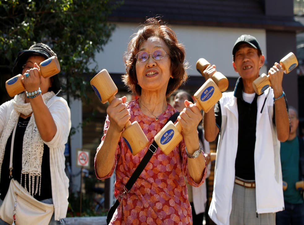 Elderly people exercise on Japan's Respect for the Aged Day in Tokyo