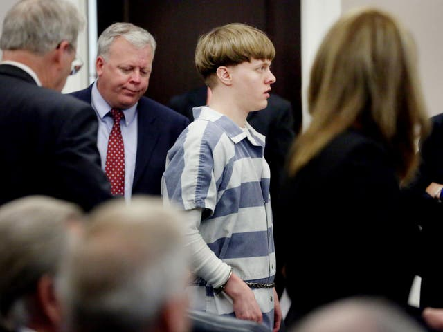 Dylann Roof is escorted into the court room at Charleston County Judicial Center to enter a guilty plea on murder charges for the 2015 shooting massacre at a historic black church in Charleston, South Carolina, on 10 April 2017