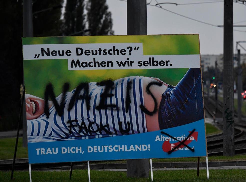 A vandalised Alternative für Deutschland campaign poster in Berlin