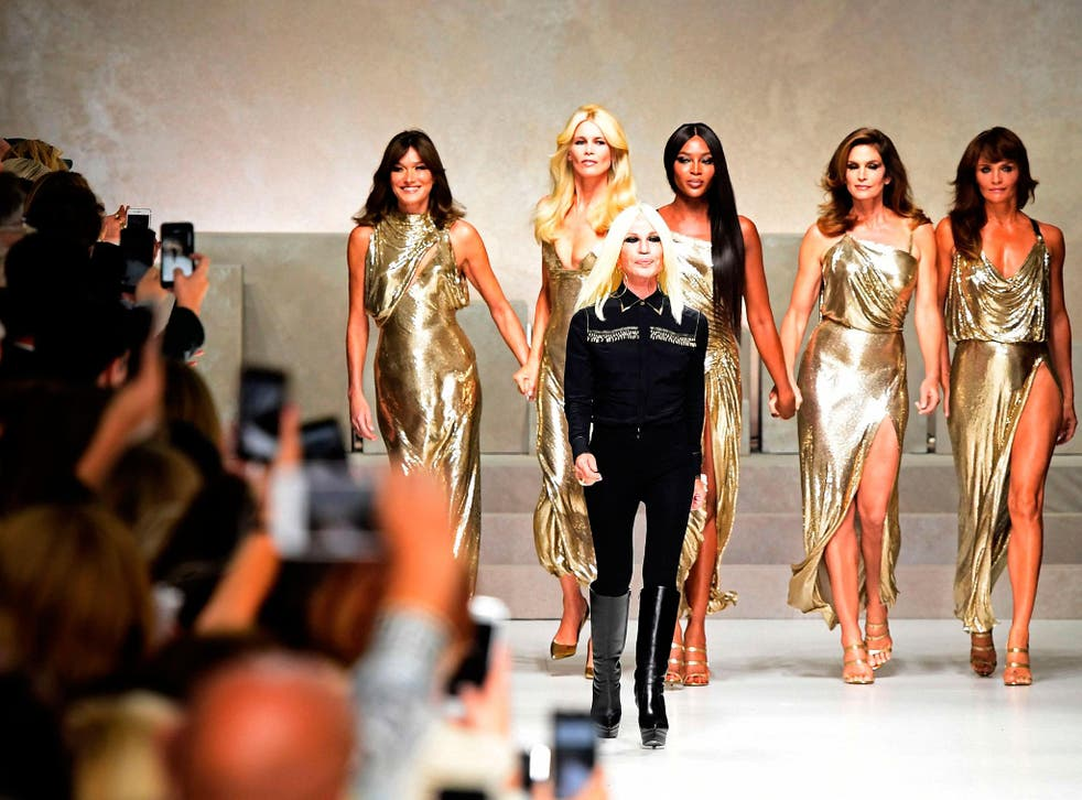 Supermodels (from left) Carla Bruni, Claudia Schiffer, Italian designer Donatella Versace (C), Naomi Campbell, Cindy Crawford and Helena Christensen walk the runway at the end of the show for Versace