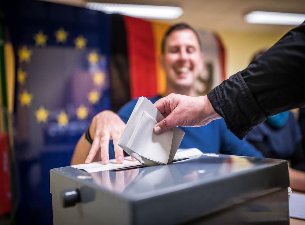 Voters turn out in Berlin to cast their ballots at a polling station during German federal elections