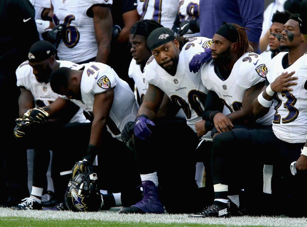 Baltimore Ravens players kneel for the American National anthem during the NFL International Series match between Baltimore Ravens and Jacksonville Jaguars at Wembley Stadium