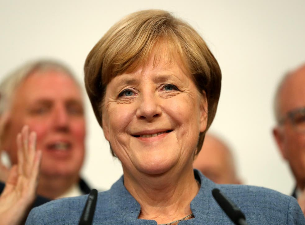 Angela Merkel speaks after initial results show her on course to win a fourth term