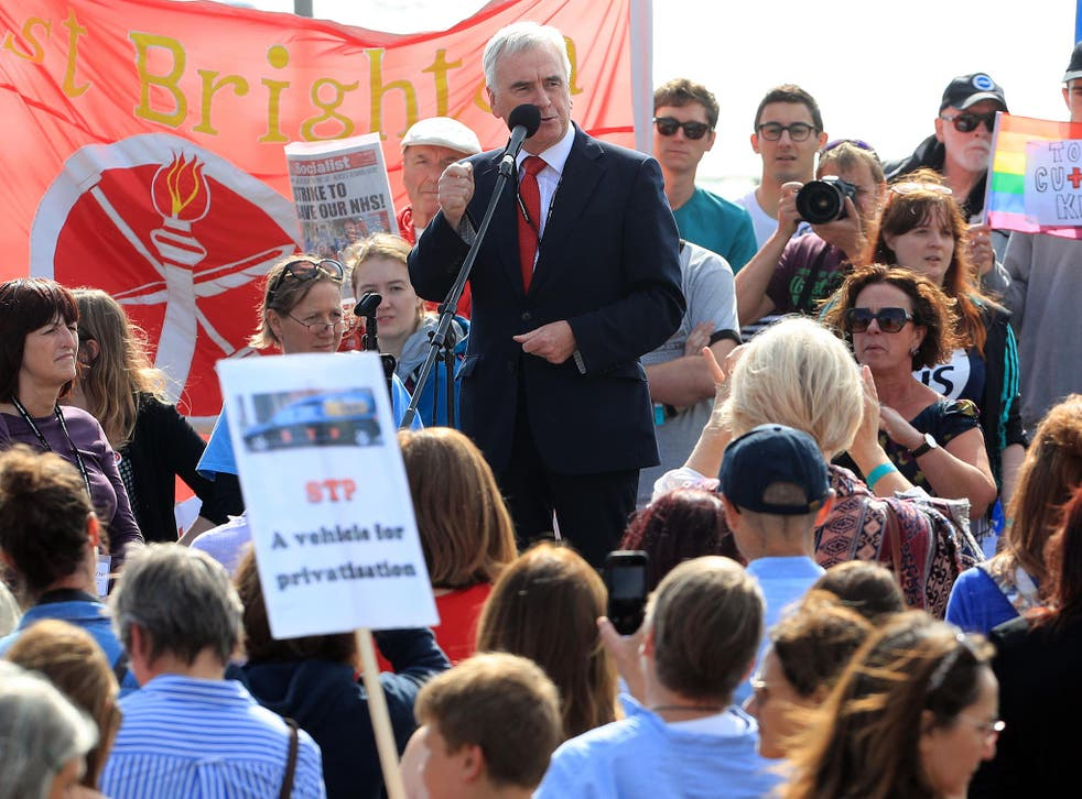 John McDonnell speaks to Labour supporters ahead of his conference speech in Brighton