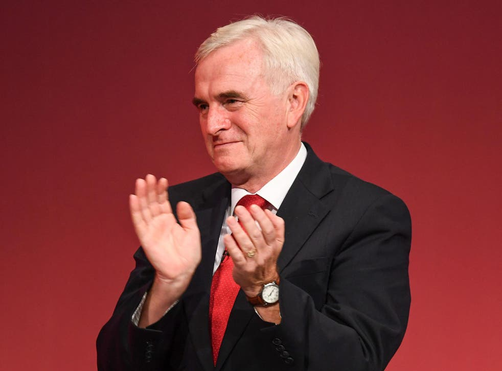 John McDonnell takes the applause of Labour delegates after vowing to take back rip-off PFI contracts