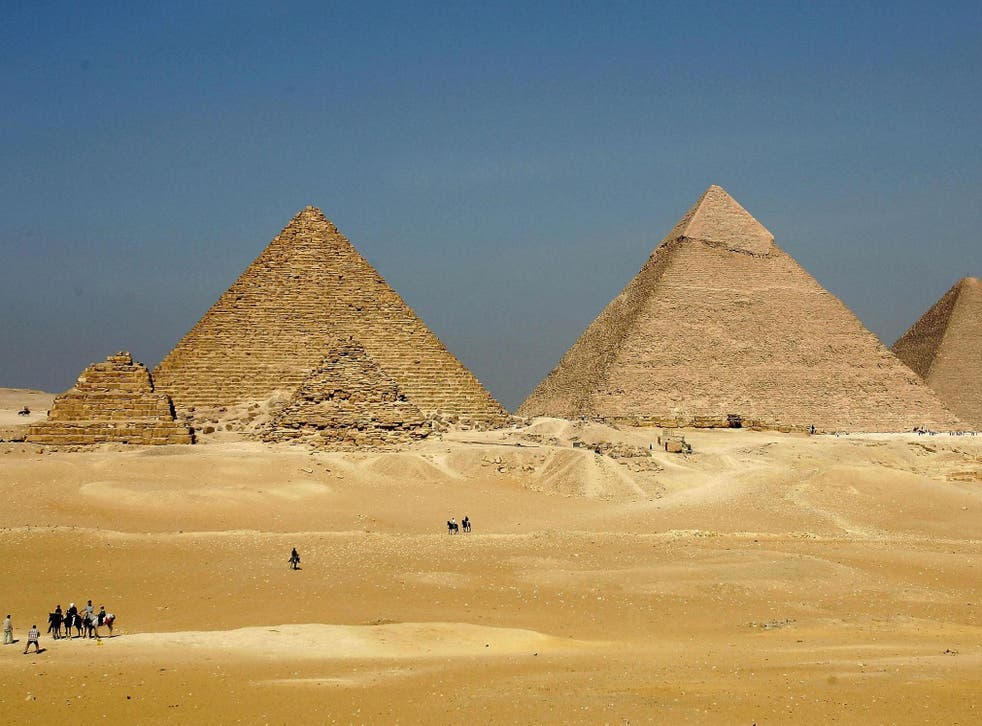 Officials have questioned how the couple managed to avoid security around the pyramids
