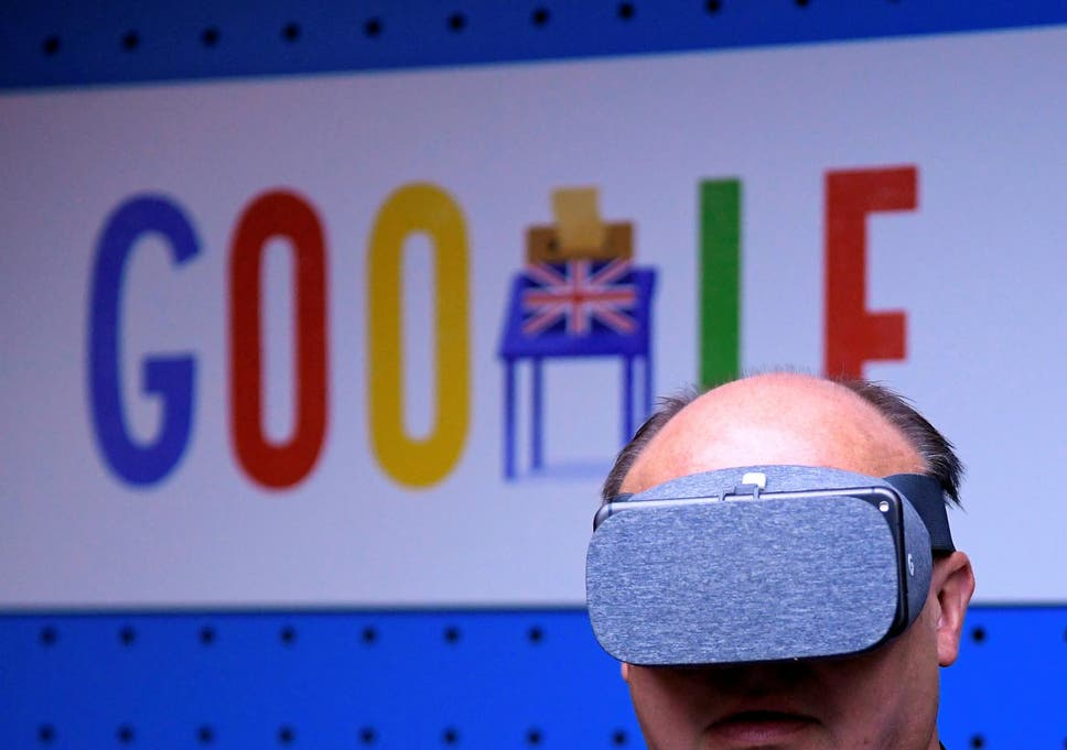 af01a5a7a42e A visitor tries a pair of VR glasses with a smartphone at the Google  digital workshop