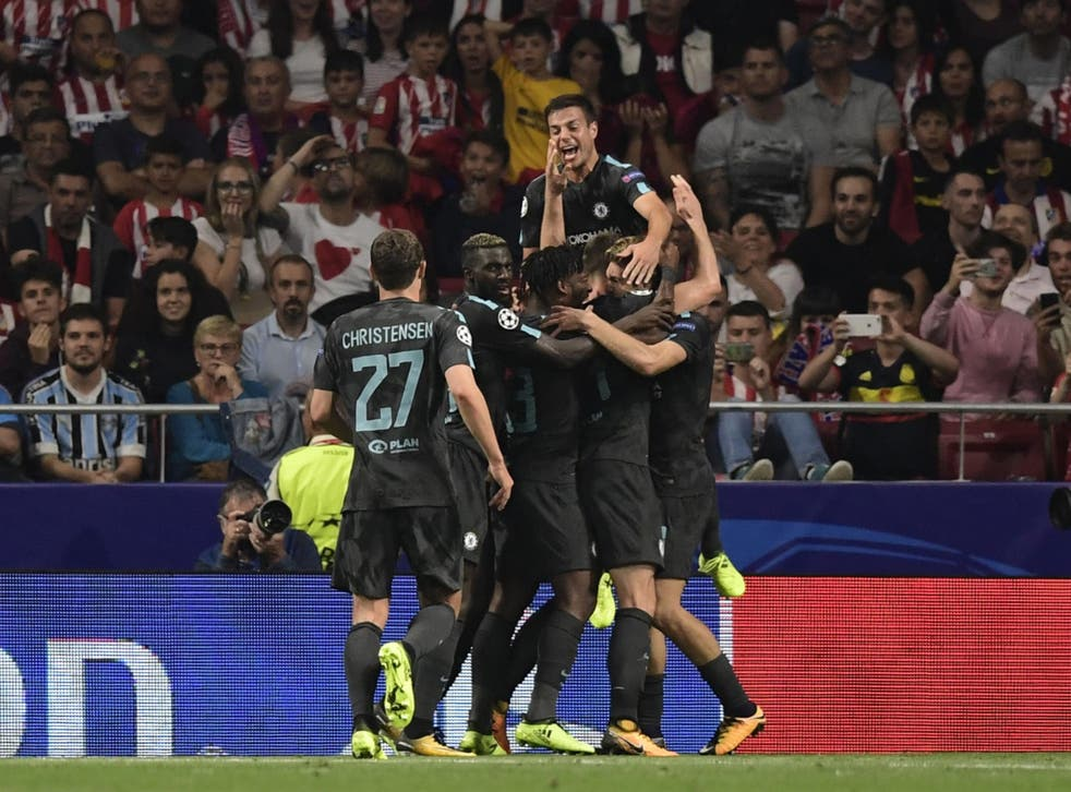 Michy Batshuayi is mobbed by his teammates after scoring Chelsea's dramatic winner