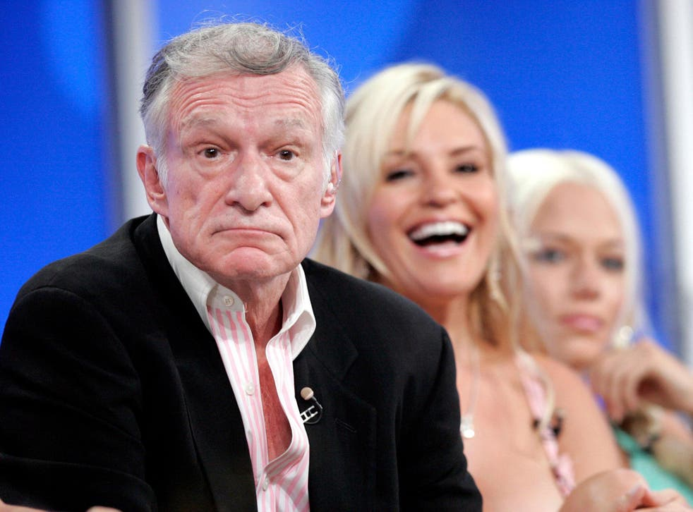 "Playboy founder Hugh Hefner at a panel discussion of his TV show ""The Girls Next Door"" in 2005"