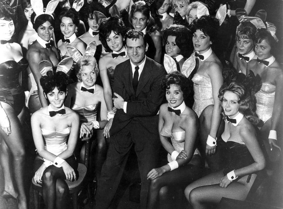 Hugh Hefner poses with Playboy Bunnies at one of America's chain of Playboy clubs in 1962, a year before Ms Steinem went undercover