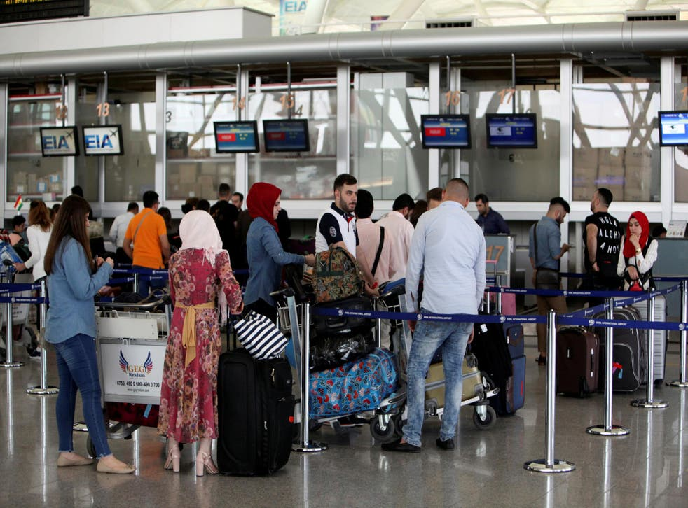 Passengers queue at the check-in counters at Irbil International Airport in Iraq on 27 September 2017