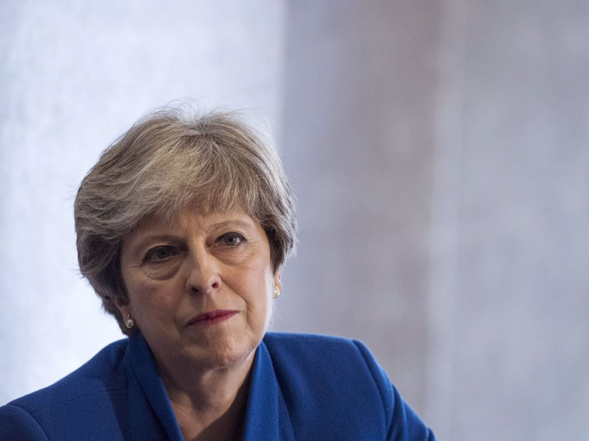 Theresa May vows to tackle racism after report reveals shocking extent of discrimination in UK