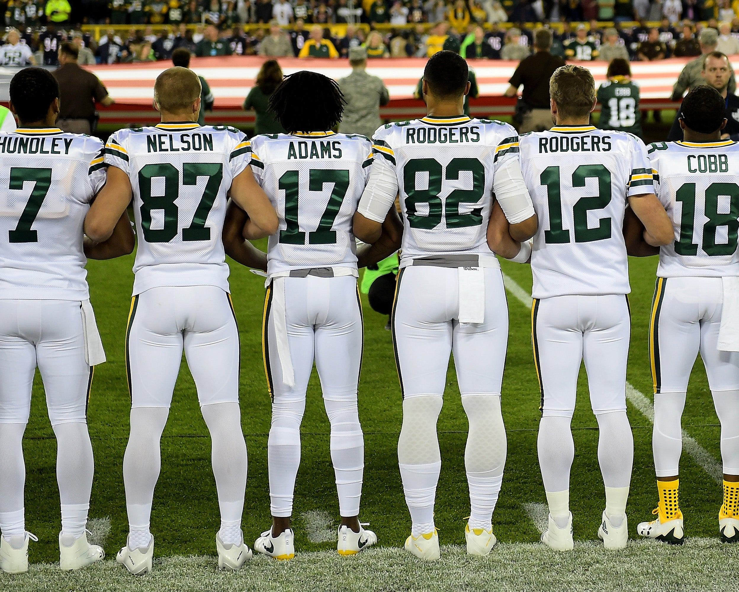 Green Bay Packers and Chicago Bears stand, link arms and refuse to kneel in protest amid Donald Trump criticism