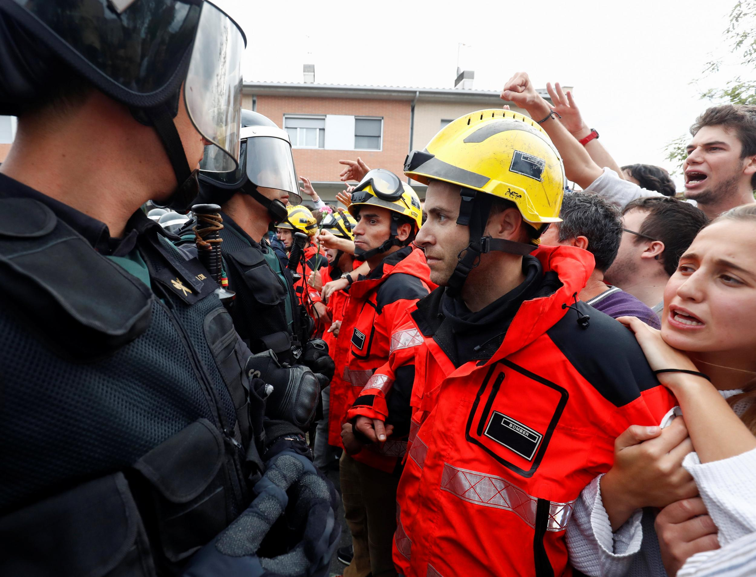 catalonia firefighters form human shield to protect referendum