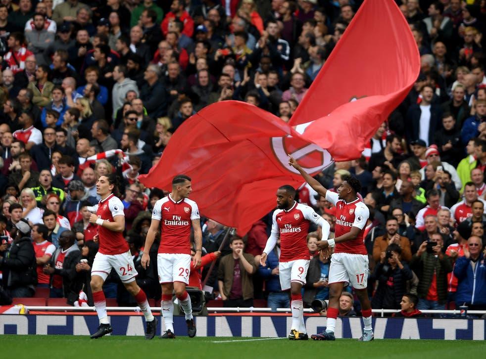 Arsenal celebrate Alex Iwobi's goal that secured a 2-0 win over Brighton