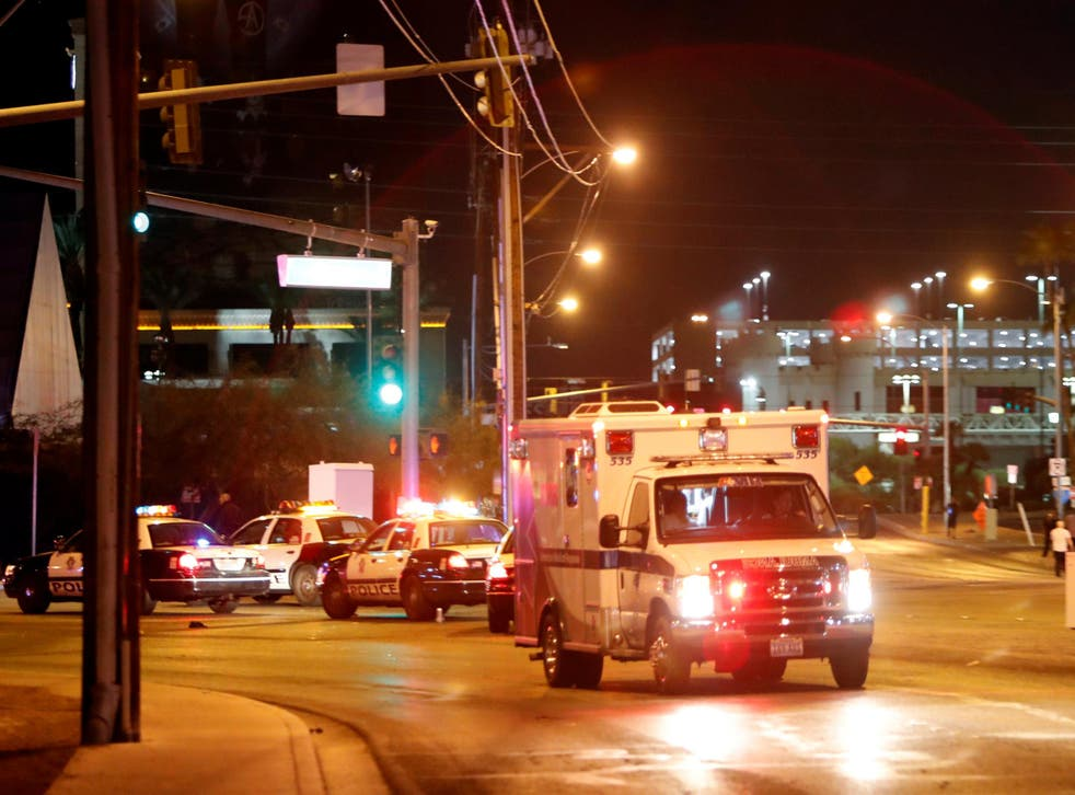 An ambulance leaves the concert venue after a mass shooting at a music festival on the Las Vegas Strip