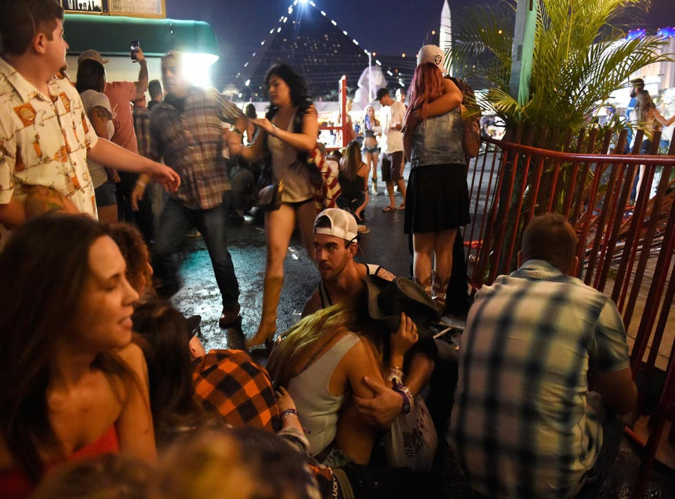 People run for cover at the Route 91 Harvest country music festival