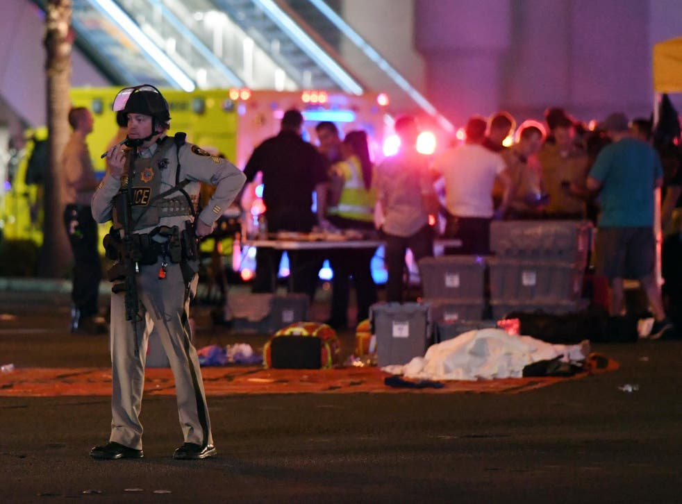 A Las Vegas Metropolitan Police officer stands near the scene of a mass shooting at a country music festival