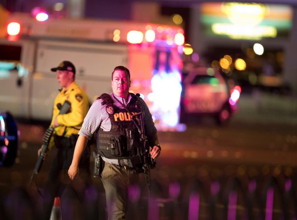 Law enforcement officers on Las Vegas Boulevard South on 2 October 2017 following the mass shooting