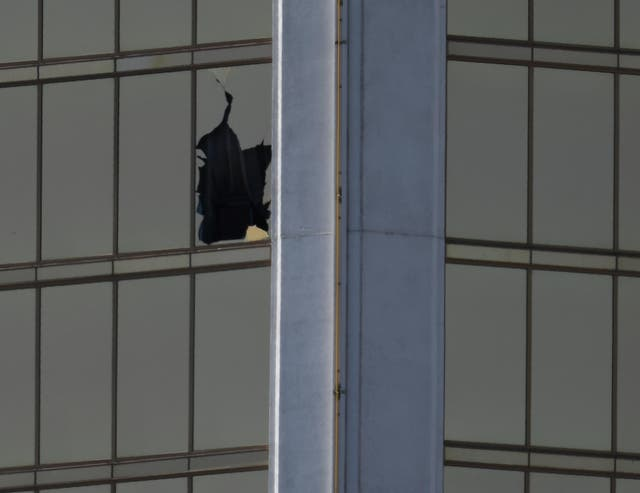 A broken window is seen at The Mandalay Bay Resort and Casino following a mass shooting at the Route 91 Festival in Las Vegas, Nevada, U.S., October 2, 2017