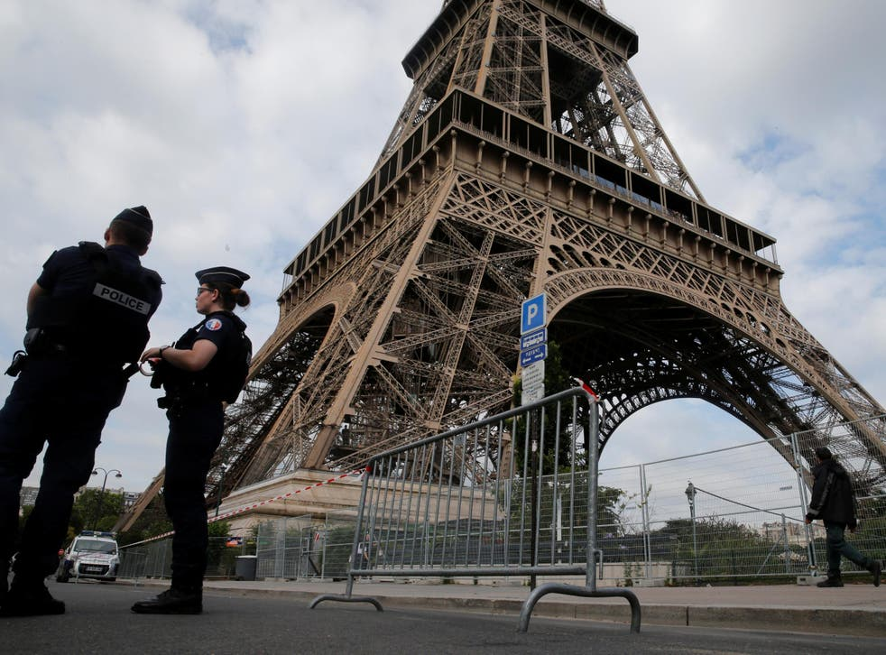 French police patrol near the Eiffel Tower as part of heightened security measures in Paris