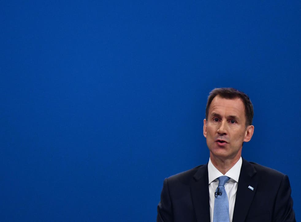 Britain's Health Secretary Jeremy Hunt delivers his speech on the third day of the Conservative Party annual conference at the Manchester Central Convention Centre in Manchester