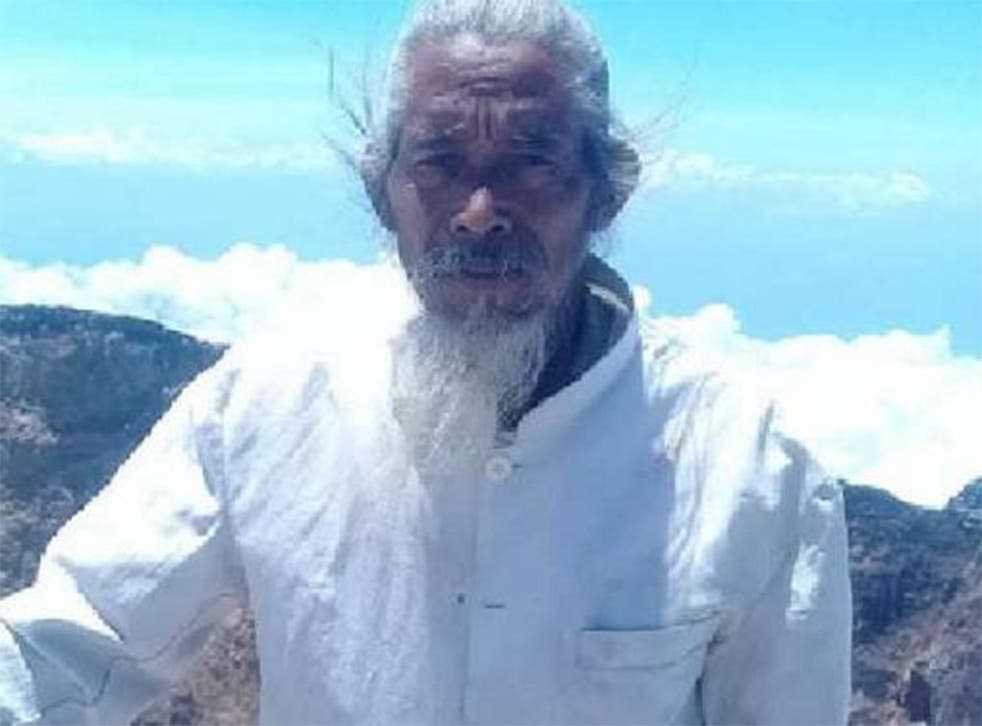 Mangku Mokok pictured at the summit of Mount Agung