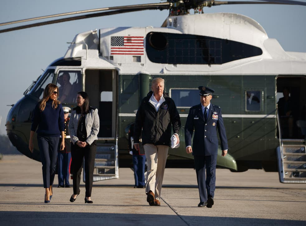President Donald Trump and first lady Melania Trump board Air Force One for a trip to Puerto Rico